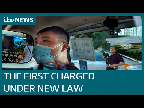 Fear descends over Hong Kong as first person to be charged under new law appears in court
